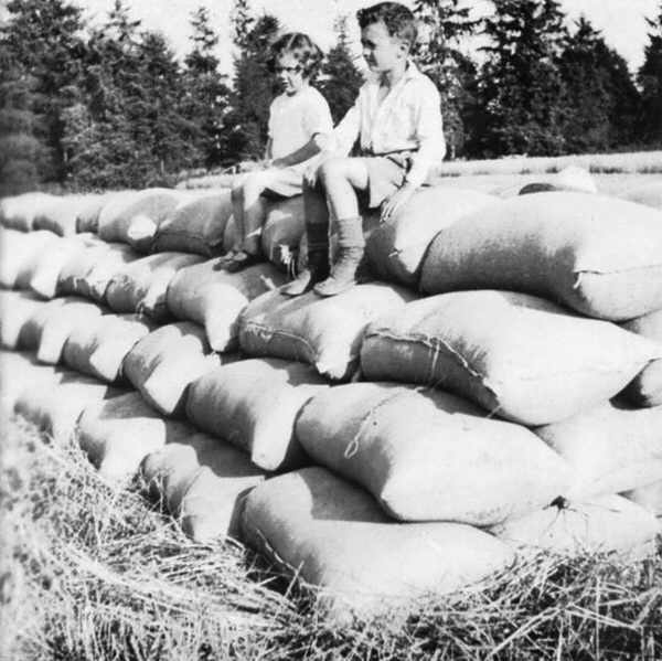 Rosemary and Bill on grain sacks