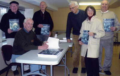 Signing Semiahmoo Trail books